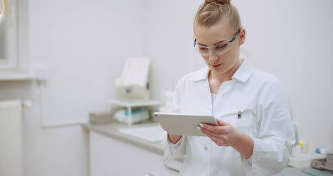Female-Doctor-Using-Digital-Tablet-At-Dental-Clinic-1