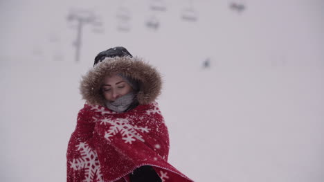 Close-Up-Of-Frozen-Woman-Wrapped-In-A-Blanket-At-Snowstorm-1