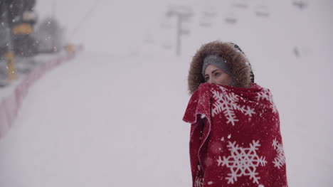 Close-Up-Of-Frozen-Woman-Wrapped-In-A-Blanket-At-Snowstorm-2