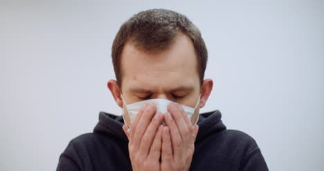 Man-With-Coronavirus-Symptoms-Wearing-Protective-Mask-1