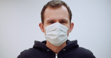 Man-With-Coronavirus-Symptoms-Wearing-Protective-Mask-2