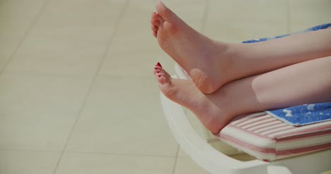 Summer-Close-Up-Of-Woman-Legs-While-Sunbathing