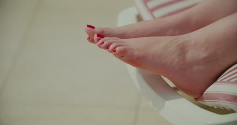 Summer-Close-Up-Of-Woman-Legs-While-Sunbathing-1