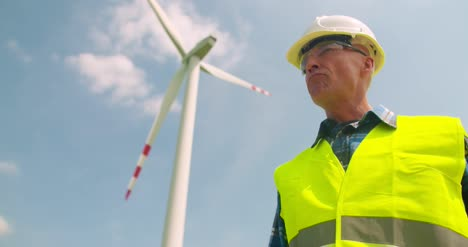 Engineer-Writing-On-Clipboard-While-Doing-Wind-Turbine-Inspection-5