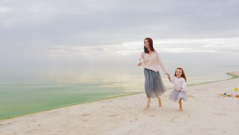 Carefree-Mother-And-Daughter-Three-Years-Running-By-The-Beach