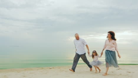 Happy-Family-Of-Three-People-Running-On-The-Beach-01