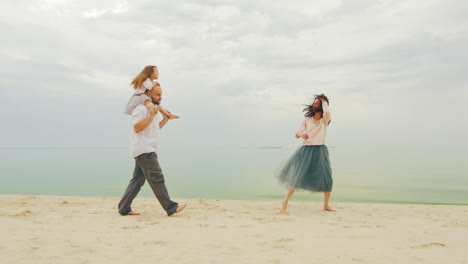 Happy-Family-Of-Three-People-Running-On-The-Beach-02