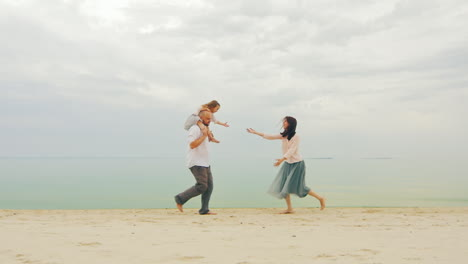 Happy-Family-Of-Three-People-Running-On-The-Beach-03