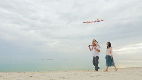 Friendly-Young-Family-Playing-With-Daughter-Fly-A-Kite-01