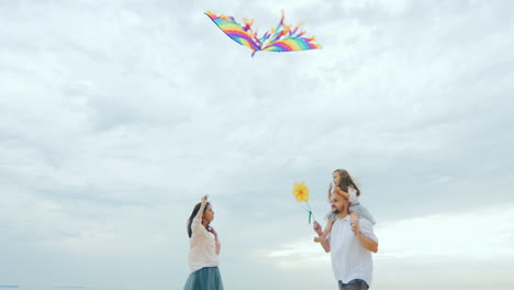 Friendly-Young-Family-Playing-With-Daughter-Fly-A-Kite-04
