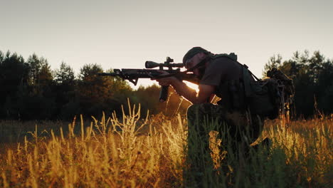 Armed-Men-In-Camouflage-It-Takes-Aim-At-The-Optical-Sight-On-The-Sunset
