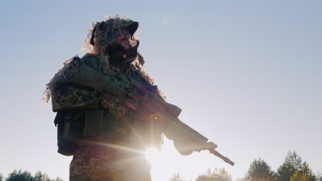 Armed-Man-In-Military-Uniform-It-Should-Be-Against-The-Sky-The-Sun-Is-Shining-From-Behind-His-Armor