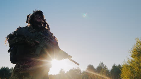 The-Soldier-In-The-American-Ammunition-Worth-Against-The-Sky-The-Sun-Shines-On-His-Arms-Lower-Angle-