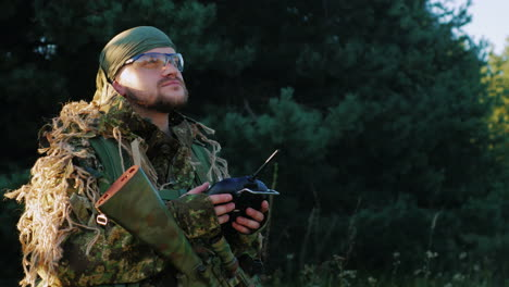 Armed-Men-In-Camouflage-Uses-A-Remote-Control-Looking-Up