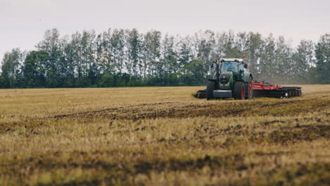 Tractor-Plowing-Land-On-The-Field-A-Flock-Of-Birds-Flying-Away