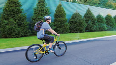 Teen-Rides-A-Bicycle-On-An-Asphalt-Road-Trim