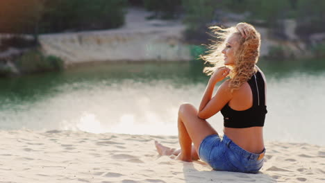 Young-Beautiful-Woman-Sitting-On-The-Beach-The-Sun-And-The-Wind-Plays-With-Her-Hair-Concept---Rest-M