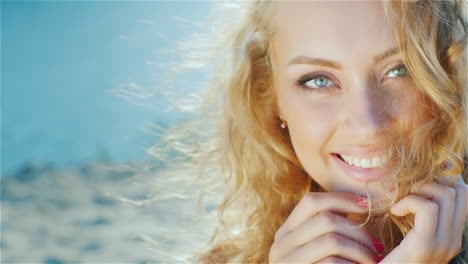 Portrait-Of-A-Young-Sexy-Woman-Smiling-At-The-Camera-Playing-With-Her-Hair-Sunny-Day-At-The-Beach-Ne