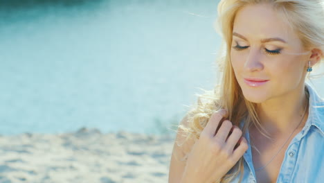 Attractive-Blonde-Smiling-At-The-Camera-Close-Up-Summer-Day-At-The-Beach-Near-The-Sea