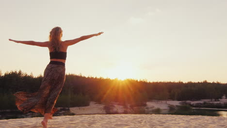 Young-Woman-In-A-Beautiful-Dress-Light-Runs-Along-The-Beach-Into-The-Sunset-Stretching-His-Arms-To-T
