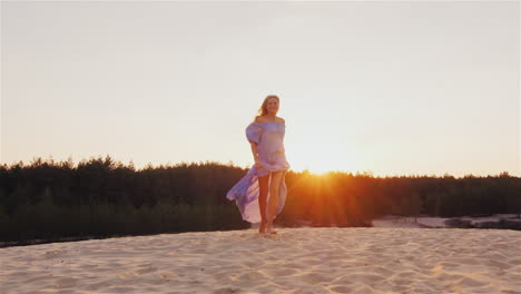 A-Young-Woman-In-A-Light-Dress-Air-Runs-At-Sunset-On-The-Beach