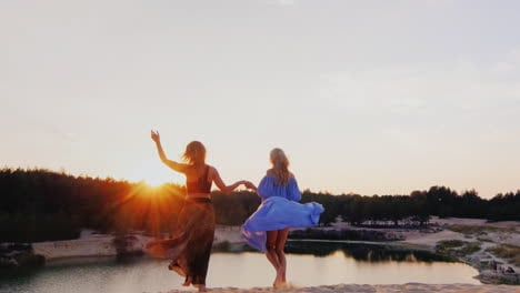 Two-Young-Women-In-A-Light-Airy-Dresses-Run-Toward-The-Sun-Concept-Freedom-Women-s-Dreams-Health-You