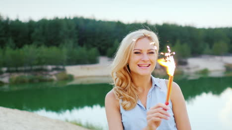 Attractive-Blonde-With-Fireworks-And-Sparkler-In-Hand-To-Have-Fun