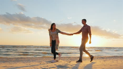Couple-Walking-On-The-Beach-At-Sunset-The-Concept---A-Happy-Honeymoon-Steadicam-Slow-Motion-Shot