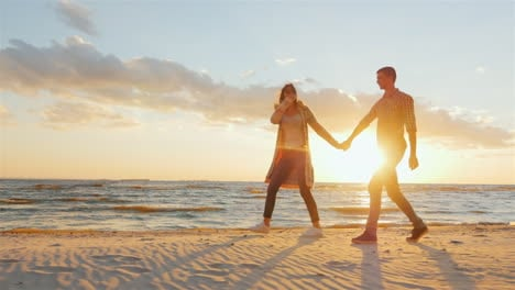 Loving-Couple-Walking-At-Sunset-On-The-Beach-Or-Lake-She-Leads-The-Guy-Flirting-Prores-Hq-10-Bit-Vid