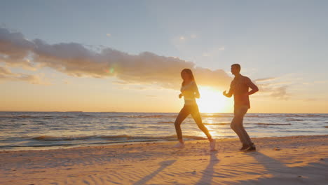 Couple-In-Love-Having-Fun-On-The-Beach-At-Sunset-Berugegu-Man-Runs-After-The-Girl-Concept---The-Hone