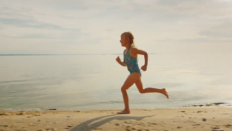 Carefree-Blonde-Girl-5-Years-Runs-Along-The-Shore-He-Laughs-Off-Her-Feet-Flying-A-Lot-Of-Water-Splas