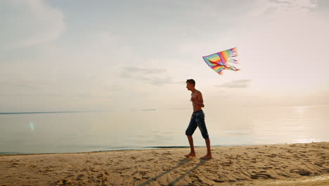 Teen-Playing-With-A-Kite-Near-The-Sea-In-The-Beautiful-Sky