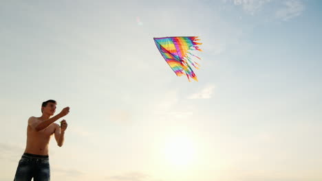 Boy-Teenager-Playing-With-A-Kite-Against-The-Background-Of-Blue-Sky-View-From-Below