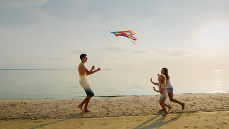 The-Elder-Brother-Is-Playing-With-His-Younger-Sisters-Running-With-A-Kite-Girls-Are-Catching-Up-With