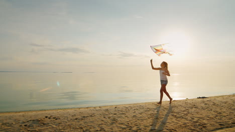 Carefree-Girl-Runs-Along-The-Beach-Playing-With-A-Kite-Slow-Motion-Steadicam-Shot