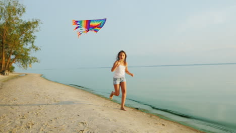 Carefree-Girl-Runs-Along-The-Beach-Playing-With-A-Kite-Steadicam-Slow-Motion-Shot