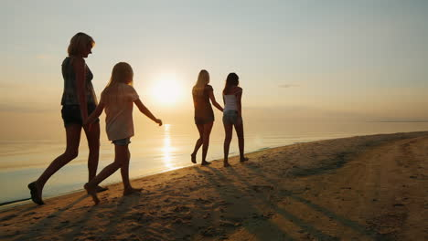 Parents-With-Children-Walk-In-The-Sand-On-The-Beach-Evening-Sunset
