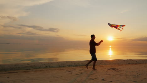 Teen-Playing-With-A-Kite-At-Sunset-Near-The-Sea-Steadicam-Slow-Motion-Shot