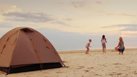 Mother-Plays-With-Two-Daughters-Blow-Bubbles-In-The-Foreground-Stands-A-Tent-A-Great-Holiday-In-Natu