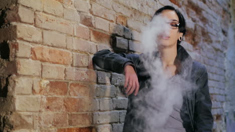 Portrait-Of-A-Casual-Young-Woman-With-Short-Black-Hair-Smokes-Electronic-Cigarette-Slow-Motion