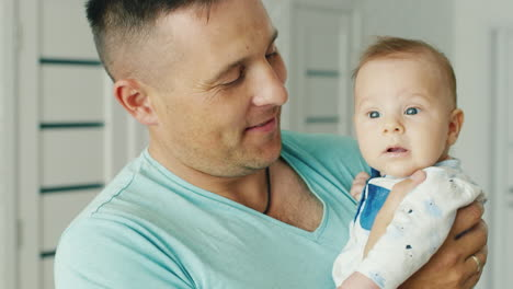 Happy-Young-Father-Holding-His-Son-Two-Months-Smiling-The-Joy-Of-Fatherhood-Happy-Childhood