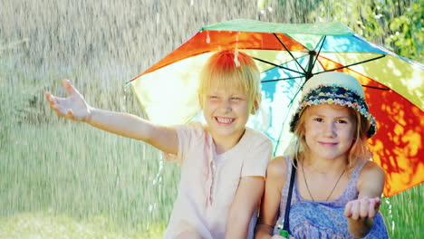 Two-Cheerful-Girlfriends-5-Years-Hiding-From-The-Rain-Under-An-Umbrella-Rainbow-Colors-Happy-Childho