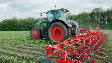 Tractor-Pulls-Field-Cultivator-Cutting-Weeds