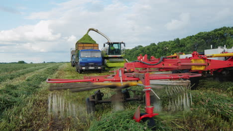 Agricultural-Harvester-Collects-Grass-In-A-Heap