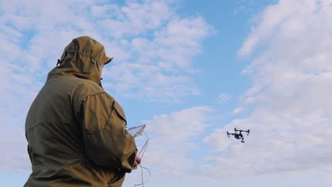 The-Man-Controls-The-Drone-Drone-Flies-Up-In-The-Sky