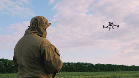 The-Man-Controls-The-Drone-The-Drone-Is-Flying-High-In-The-Sky-The-Camera-Follows-The-Drone