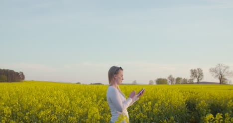 Young-Farmer-Using-Digital-Tablet-At-Oilseed-Rape-Field-7