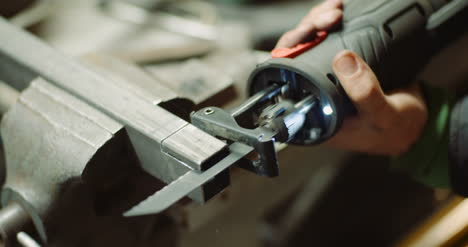 Industry-Worker-Metal-Part-With-Electric-Hacksaw-13