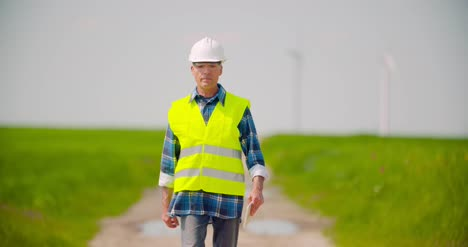 Engineer-Using-Digital-Tablet-While-Wind-Turbine-Inspection-At-Windmill-Farm-6