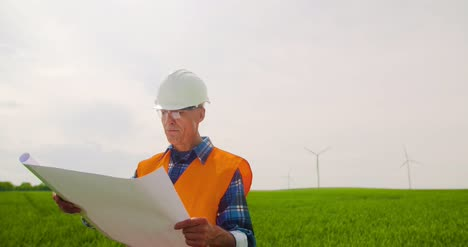 Engineer-Writing-On-Clipboard-While-Doing-Wind-Turbine-Inspection-11